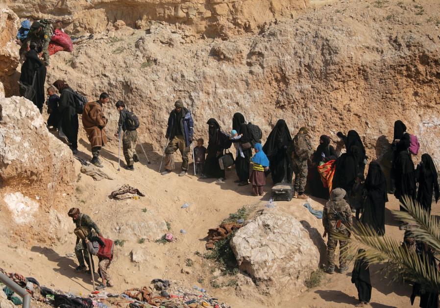 WOMEN AND their families surrender in the last ISIS-held area in Syria last month