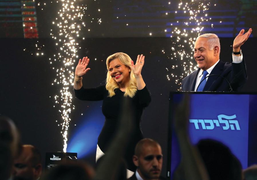 BENJAMIN AND Sara Netanyahu celebrate in Tel Aviv on election night