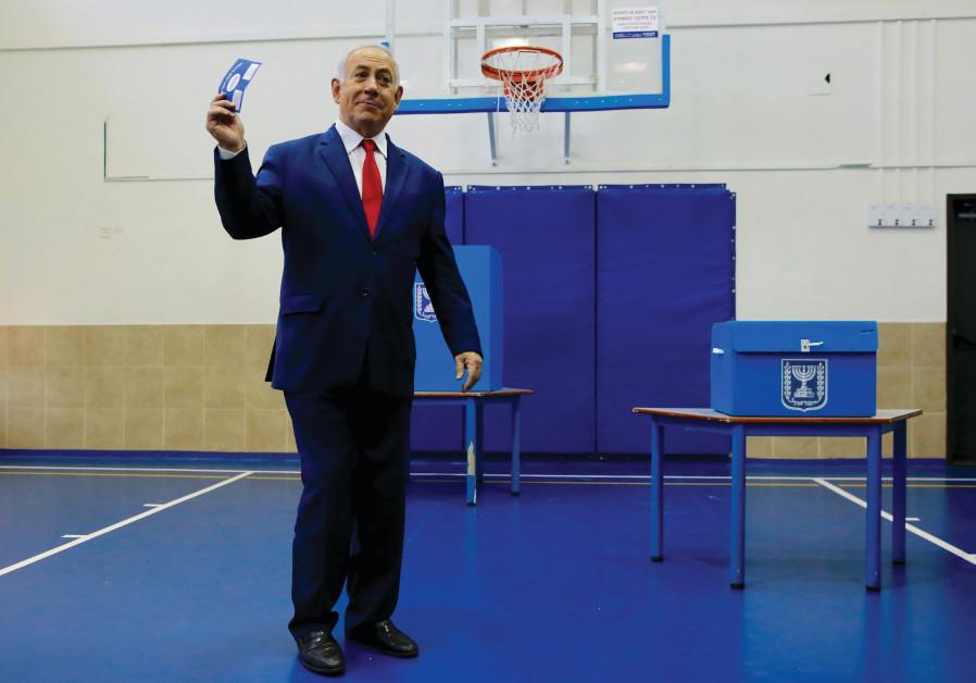 PRIME MINISTER Benjamin Netanyahu votes Tuesday in Jerusalem