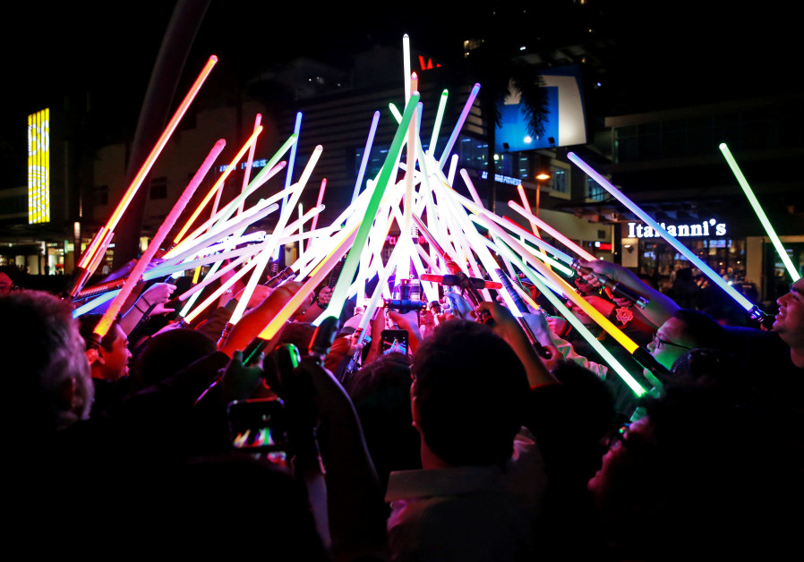 Star Wars enthusiasts huddle with their lightsabers after participating in Earth Hour at Taguig City