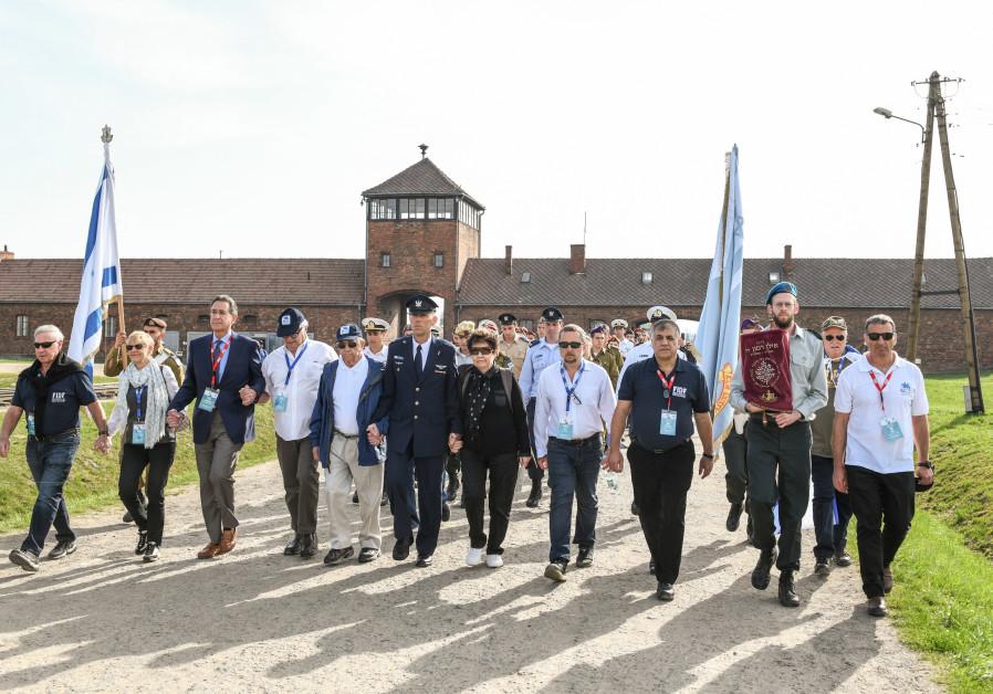 The FIDF delegation marches into Auschwitz-Birkenau in 2018.
