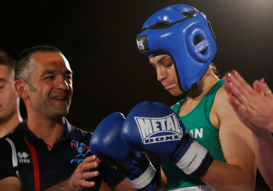 Iranian woman boxer cancels return home after arrest warrant issued