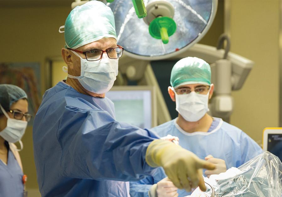 DR. NEVO MARGALIT directs a complex neurosurgery. (Jared Bernstein)