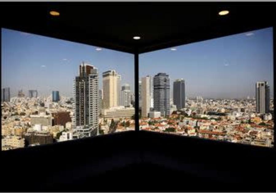 A general view of Tel Aviv's skyline is seen through a hotel window in Tel Aviv, Israel May 15, 2017