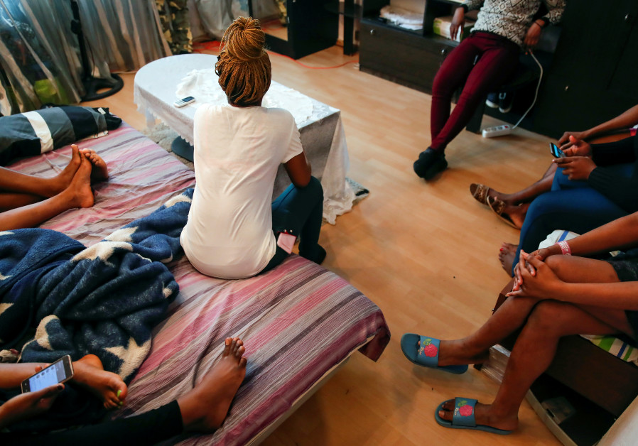 Young Nigerian women, rescued from human traffickers, gather in a shelter on the outskirts of Moscow