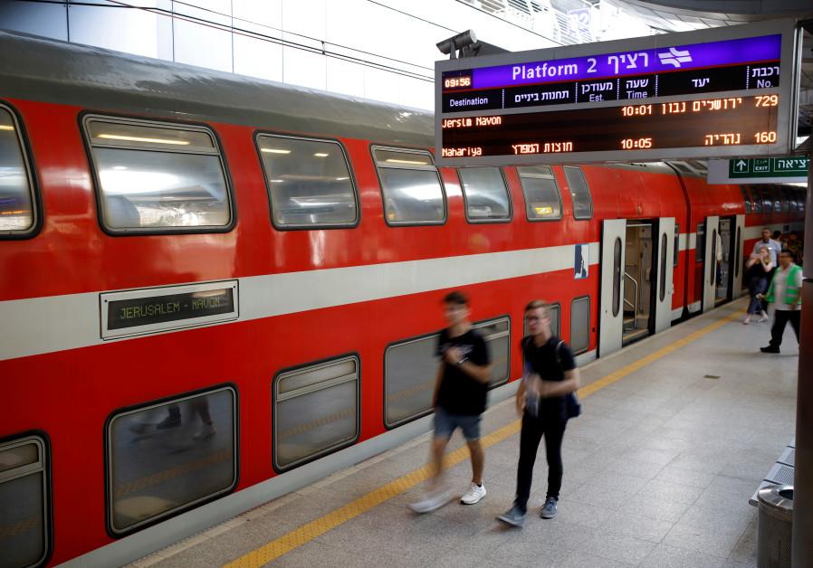 People walk on the platform at Israel's new high-speed rail line station at Ben Gurion International