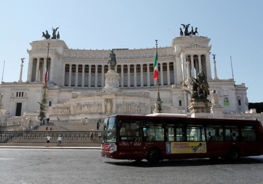 A public bus is seen in downtown Rome, Italy