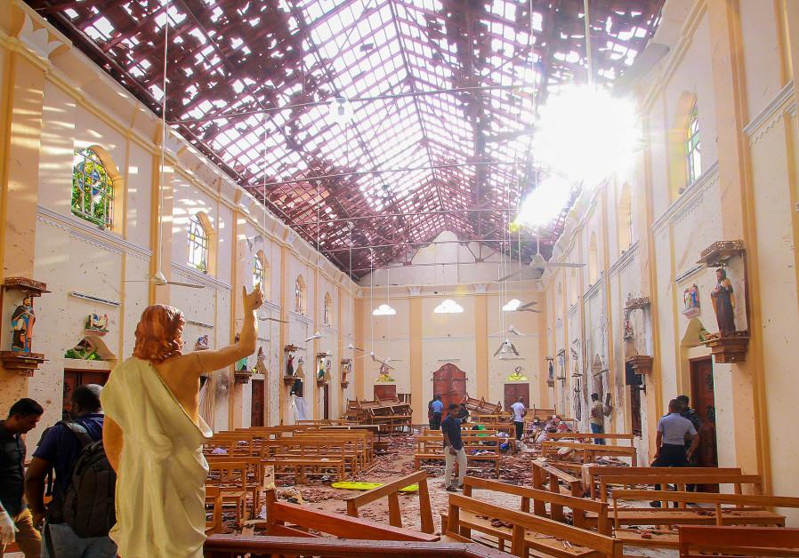 A blood-spattered statue of Jesus Christ inside St Sebastian's Church in Negombo, Sri Lanka April