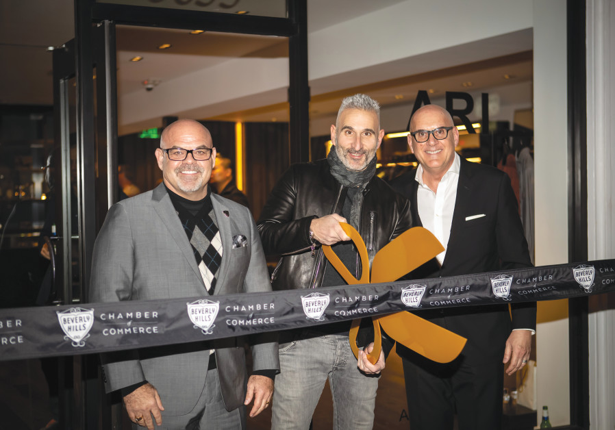 MOSHE BEN-ARI (center) at the opening of his Ari boutique in Los Angeles. (Courtesy)