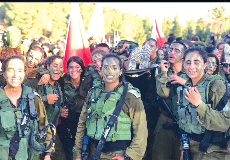 Women from a mixed IDF Combat Unit pose during a training exercise (Credit:  IDF SPOKESMAN'S UNIT)