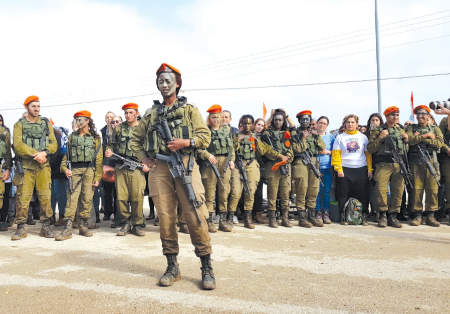 Ambat (center). a lieutenant first class in the Home Front Command, looked forward to Passover on base with her fellow soldiers (Credit:  IDF SPOKESMAN'S UNIT)