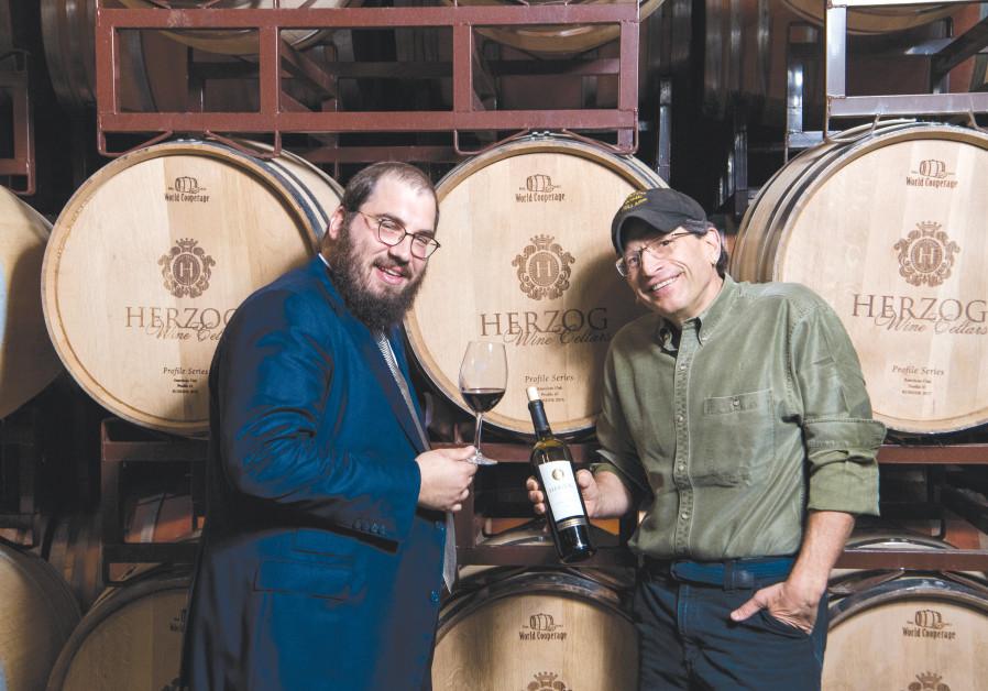 Winery CEO Joseph Herzog (left) raises a glass with winemaker Joe Hurliman