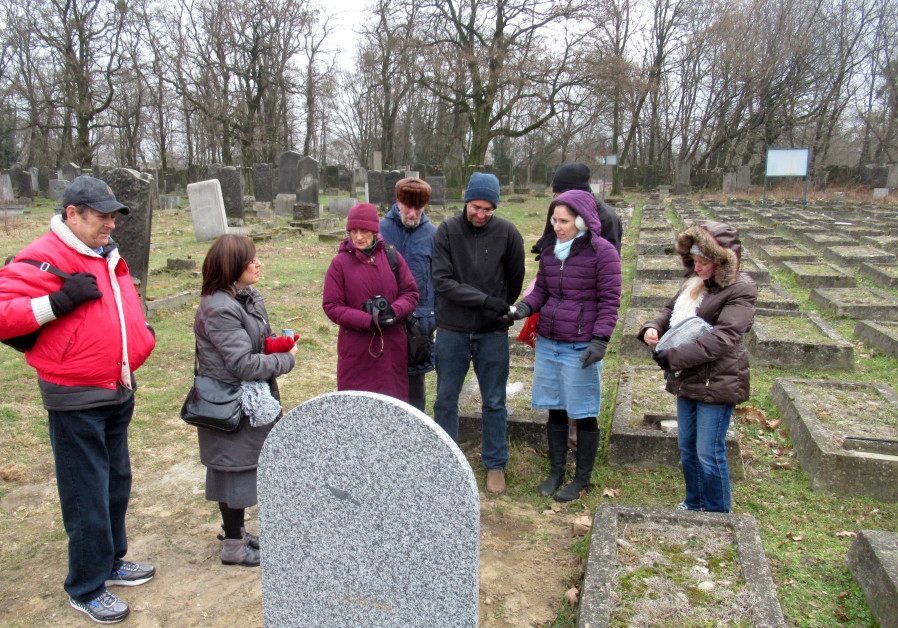 Lizzie Rubin and brother Mark Tark join other relatives of Holocaust survivors at the Lodz Jewish cemetery in Poland (Credit: Courtesy)