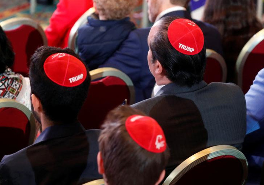 Men wear Trump yarmulkes while waiting for U.S. President Donald Trump to address the Republican Jew