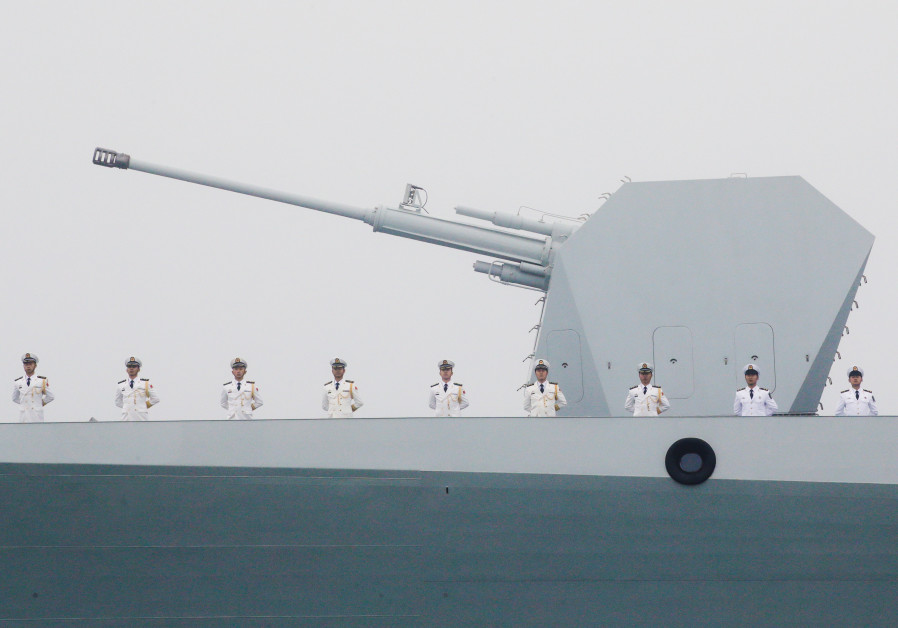 THE CHINESE navy's destroyer 'Taiyuan' takes part in a naval parade