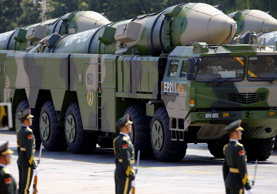 FILE PHOTO - Military vehicles carrying DF-21D ballistic missiles roll to Tiananmen Square
