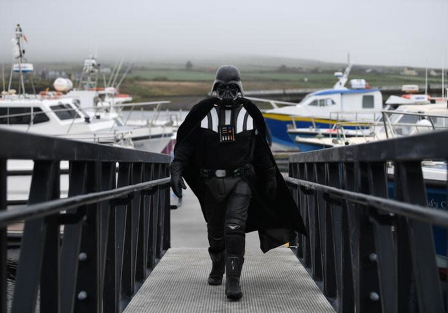 A Star Wars fan dressed in costume as Darth Vader