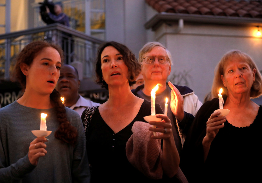 A candlelight vigil is held at Rancho Bernardo Community Presbyterian Church for victims of a shooti