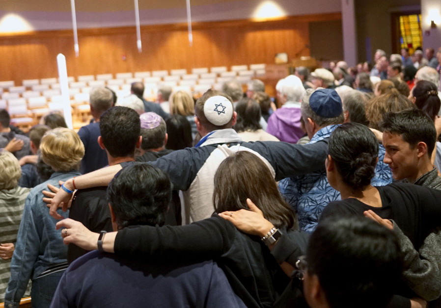 Mourners participate in a vigil for the victims of the Chabad of Poway Synagogue, April 27, 2019