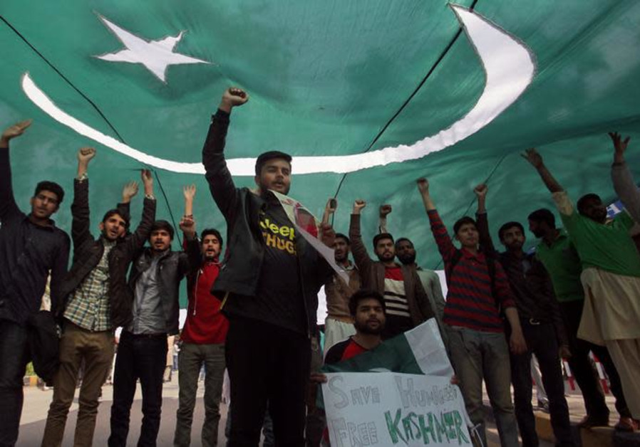 Students chant slogans under the shade of national flag