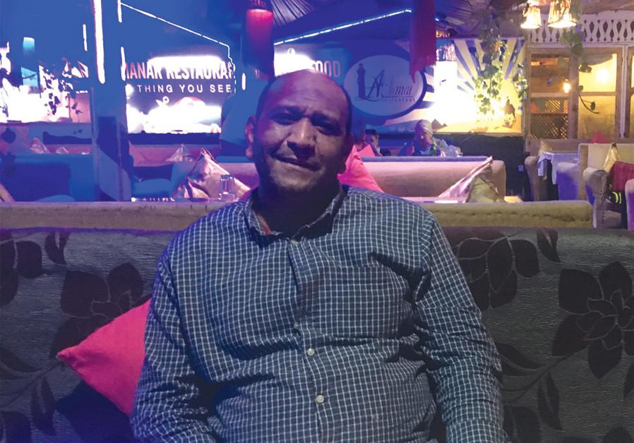 Mohamed Osama Ahmed sitting at his restaurant in Dahab (photo:JOHN COLIN MARSTON / SAINT CATHERINE)