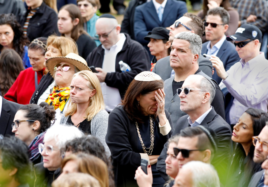 A crowd watches on screen the funeral for Lori Gilbert-Kaye on April 29, 2019