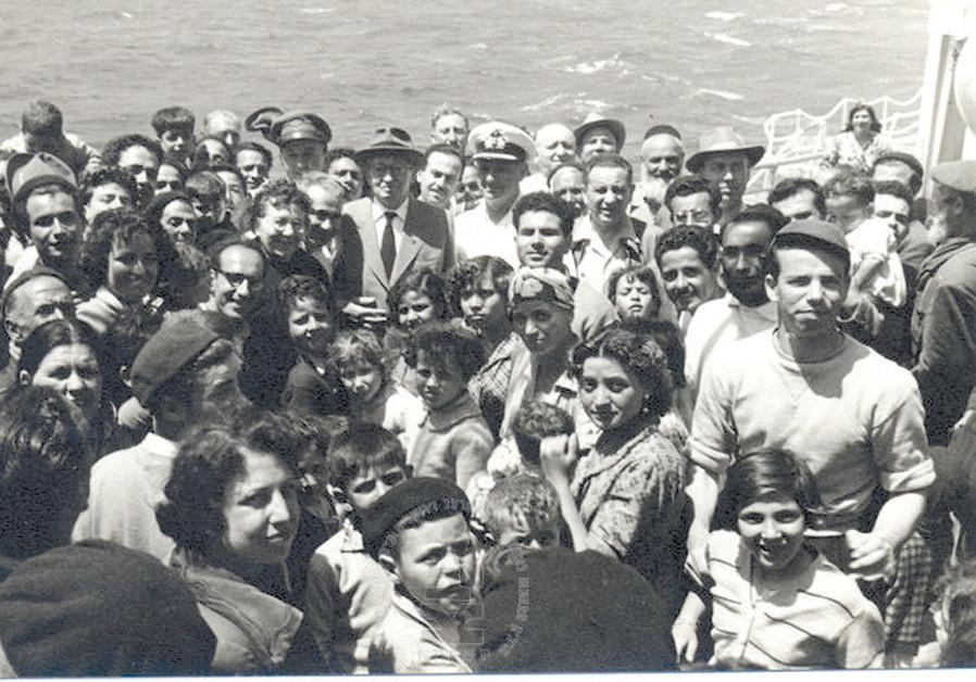THEN-PRESIDENT Yitzhak Ben-Zvi and his wife Rachel Yana'it Ben-Zvi with new immigrants from North Africa, aboard the ship 'Negba' in 1955 (Credit: ROBERT MILSHTOK/YAD BEN ZVI PHOTO ARCHIVES)