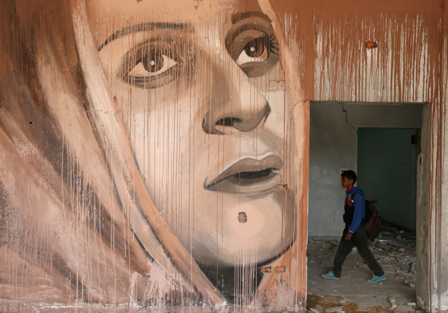 A mural painted by Palestinian artist Ali Al-Jabali in a destroyed building in Gaza (REUTERS/IBRAHEEM ABU MUSTAFA)