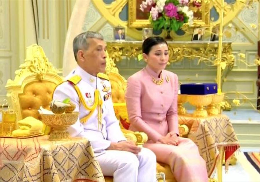 King Maha Vajiralongkorn and his consort, General Suthida Vajiralongkorn named Queen Suthida attend
