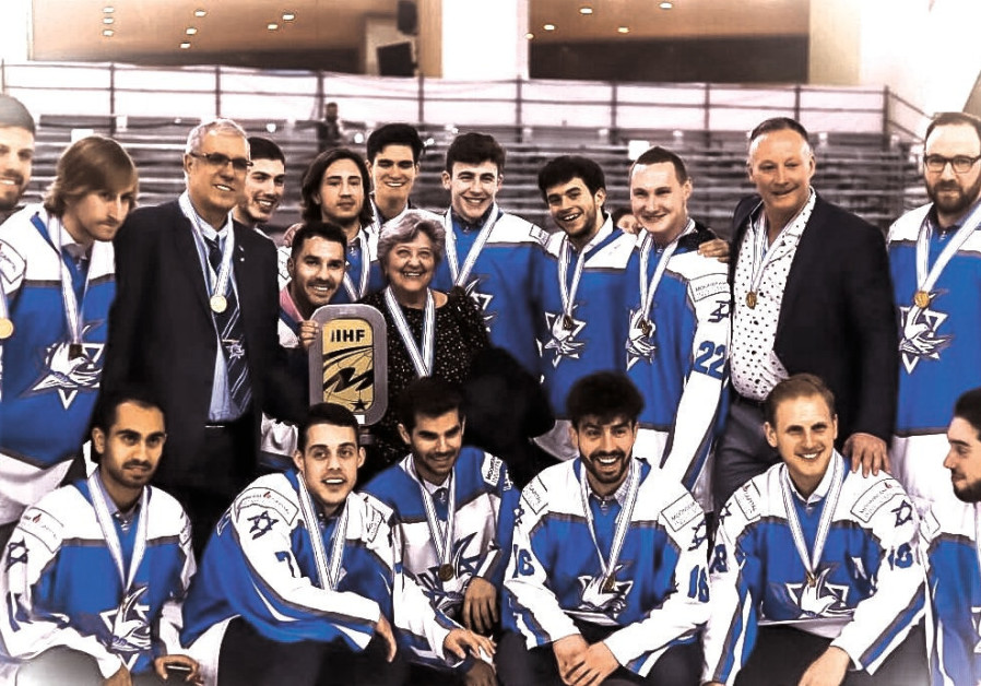 THE ISRAEL MEN'S national team poses on the ice following its gold-medal winning performance this we