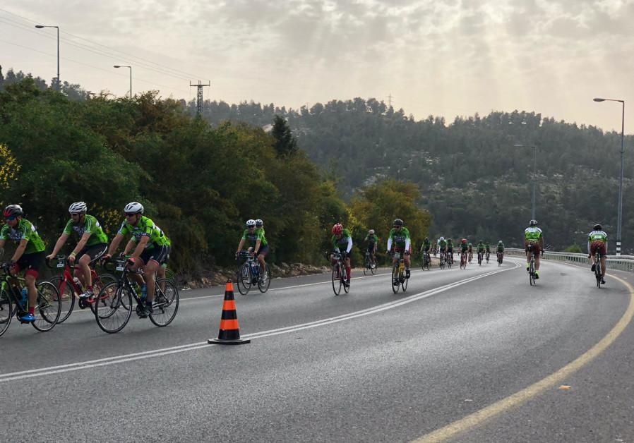 Racers bike through Jerusalem at the GFNY