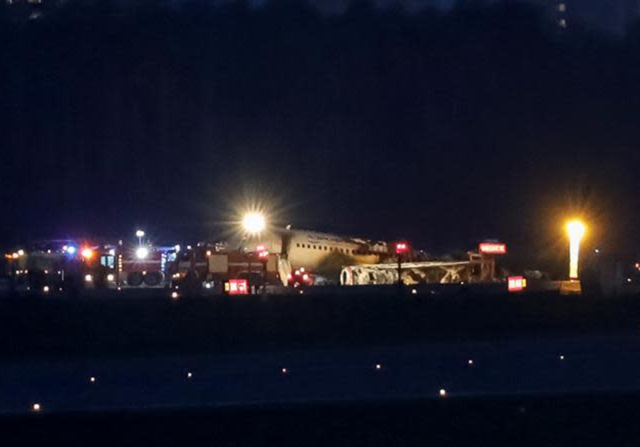 The wreckage of a passenger plane is seen after an emergency landing at the Sheremetyevo Airport