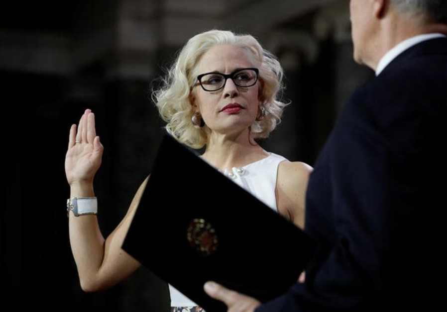 Sen. Kyrsten Sinema (D-AZ) participates in a mock swearing in with U.S. Vice President Mike Pence du