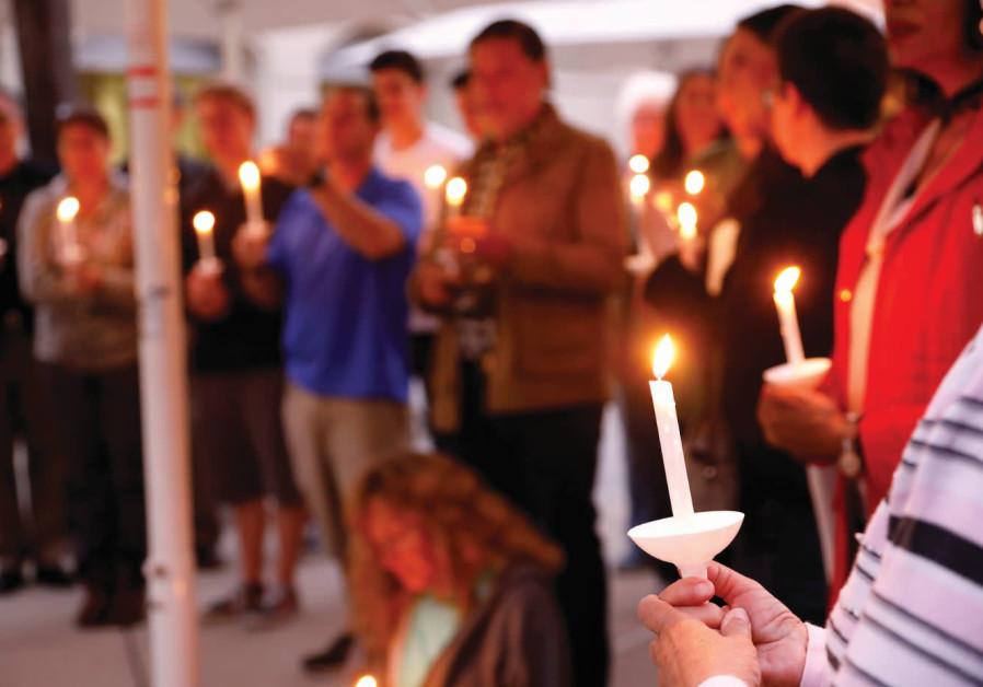A CANDLELIGHT VIGIL is held last month at Rancho Bernardo Community Presbyterian Church for victims