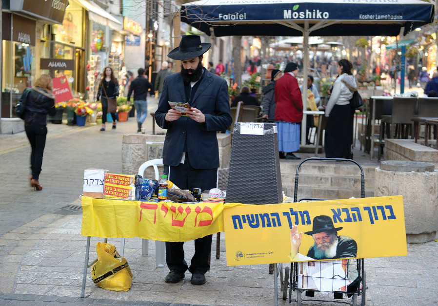A MEMBER of the Chabad community waits at a tefillin stand in Jerusalem. (Credit: MOSHE MILNER / GPO)