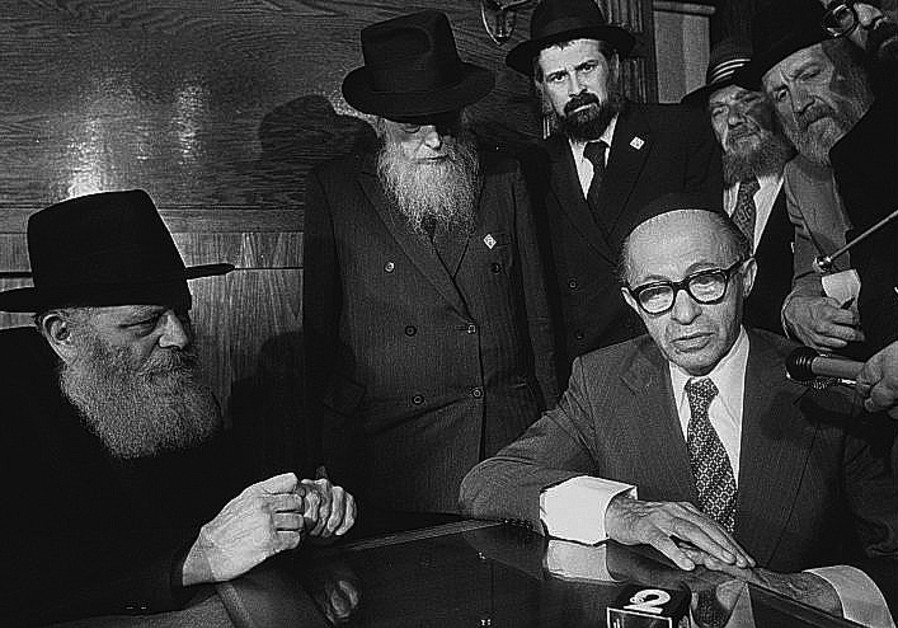 RABBI MENACHEM Schneerson meets with then-prime minister Menachem Begin in Brooklyn. (Credit: YAACOV SAAR/GPO)