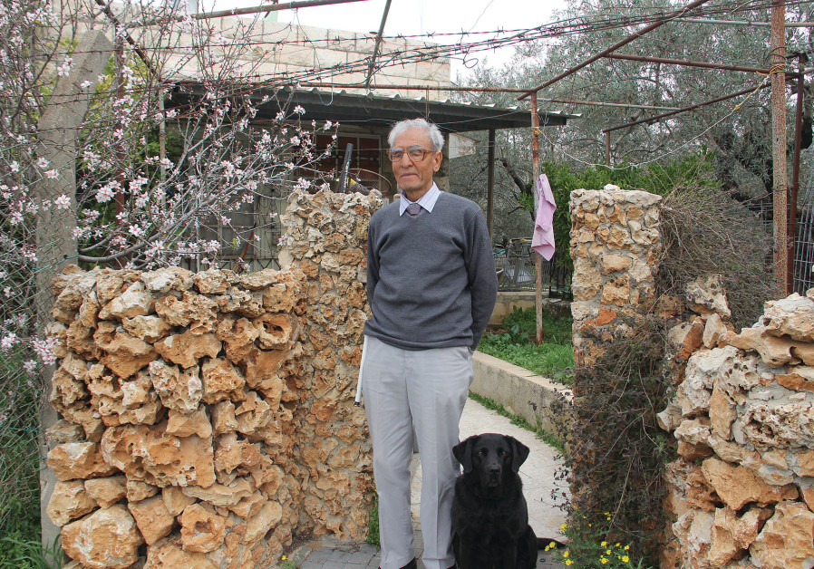 IBRAHIM ELAYAM and his guide dog stand outside his family home in the Beit Safafa neighborhood of Je