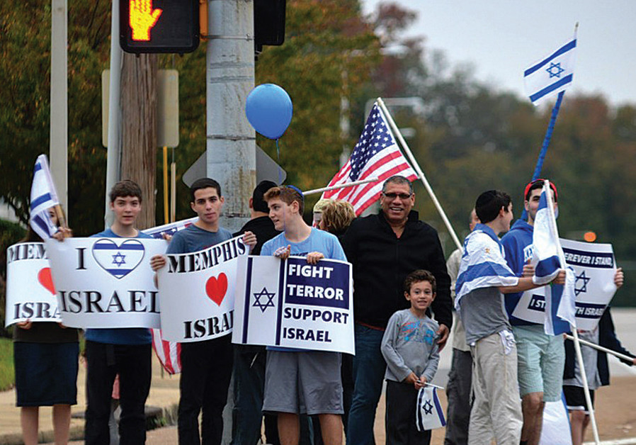 YOUTH IN Memphis wave flags and  hold signs in support of Israel. ( credit: TORAH MITZION MEMPHIS)