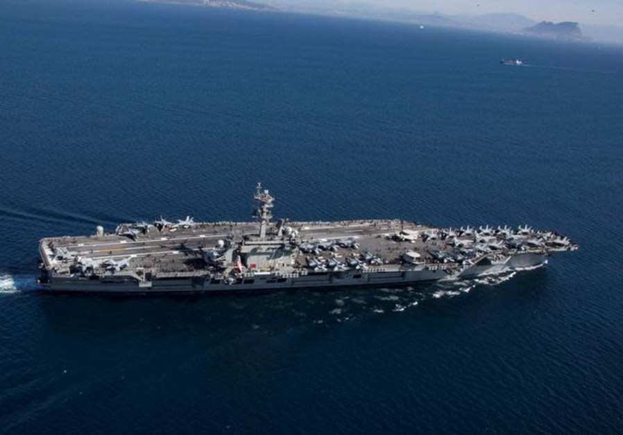 The Nimitz-class aircraft carrier USS Abraham Lincoln (CVN 72) transits the Strait of Gibraltar