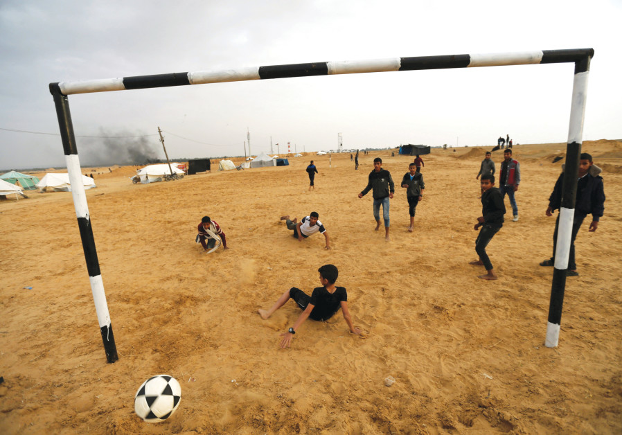 PALESTINIANS PLAY soccer at a tent city in the southern Gaza Strip last year.