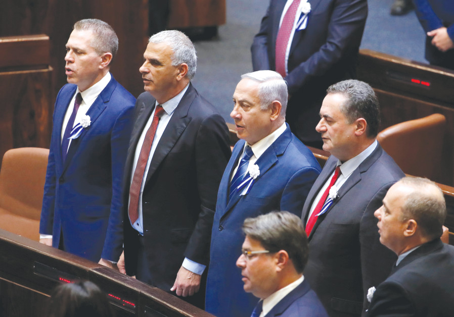 PRIME MINISTER Benjamin Netanyahu and current cabinet ministers sing 'Hatikvah' during the inaugurat