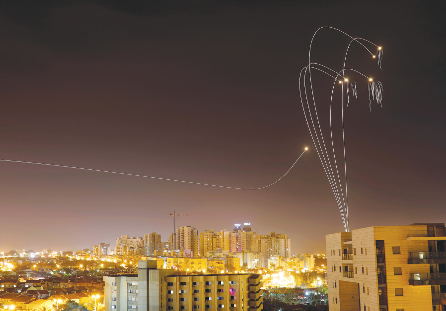 THE IRON DOME air defense system fires interceptor missiles over Ashkelon on Sunday.