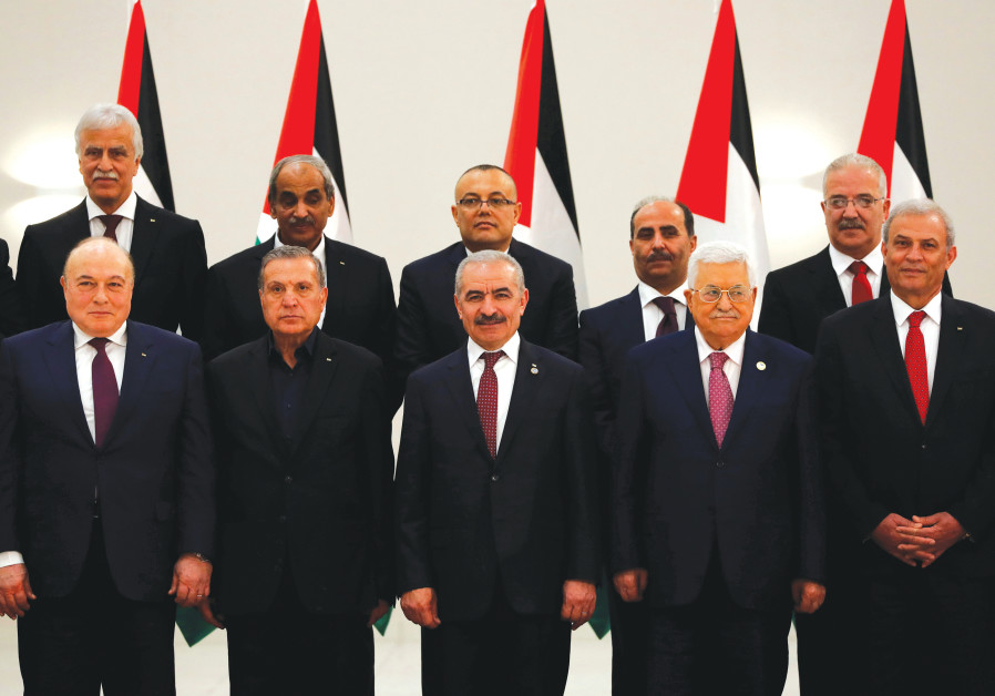 PALESTINIAN AUTHORITY PRESIDENT Mahmoud Abbas, Prime Minister Mohammad Shtayyeh (third left) and oth