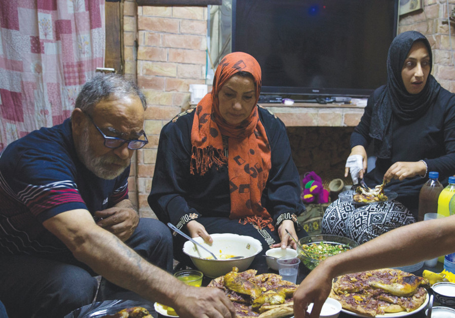 Palestinian officials in hot water over Ramadan meal with Israelis