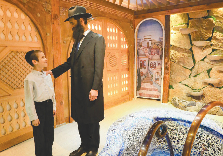 NEW MIKVE in Seoul: Litzman and co. next to the ritual bath (Credit: Courtesy)