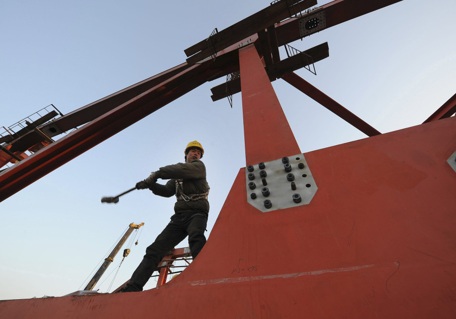A labourer works at a high-speed railway viaduct construction site in Hefei, Anhui province