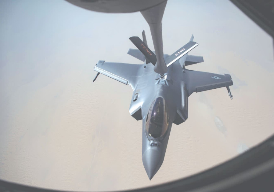 AN AIRMAN piloting a US Air Force F-35A Lightning II receives fuel from a KC-135 Stratotanker at an