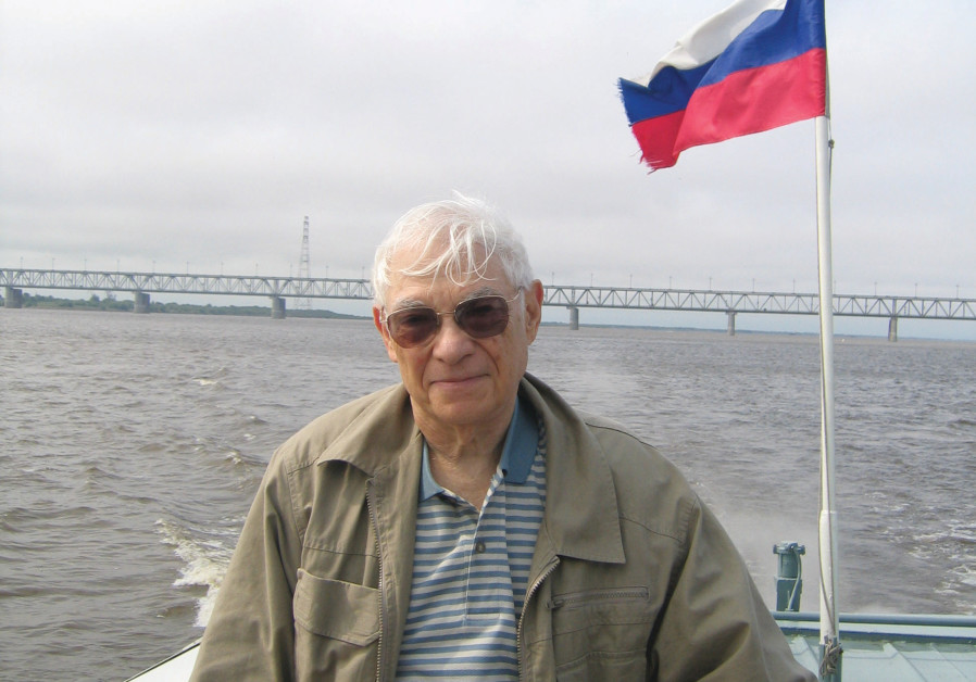HE AUTHOR moving down the Amur River at Khabarovsk. An old bridge in the background crossing the Amur is the border between Russia and China. (photo credit: BEN G. FRANK)