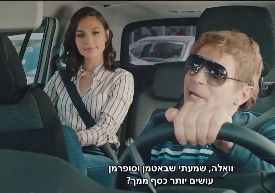 Gal Gadot sits in the back of a cab with driver Yuval Semo in her Eurovision video appearance