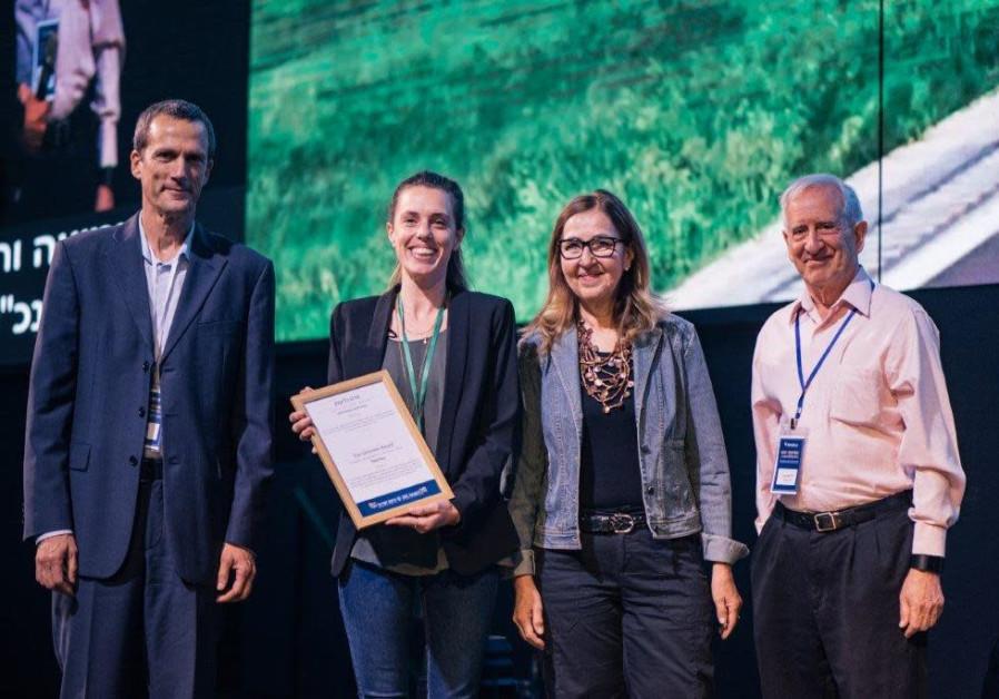 The creators of the MUCA project win the Glickman Prize. (Courtesy)